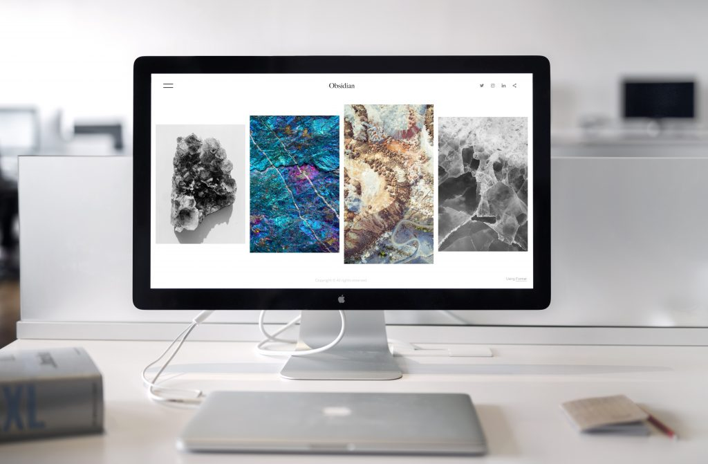 multimedia arts college course uses modern tools such as Mac.