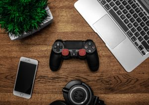 Laptops, headset, phones, and console, used for game development jobs