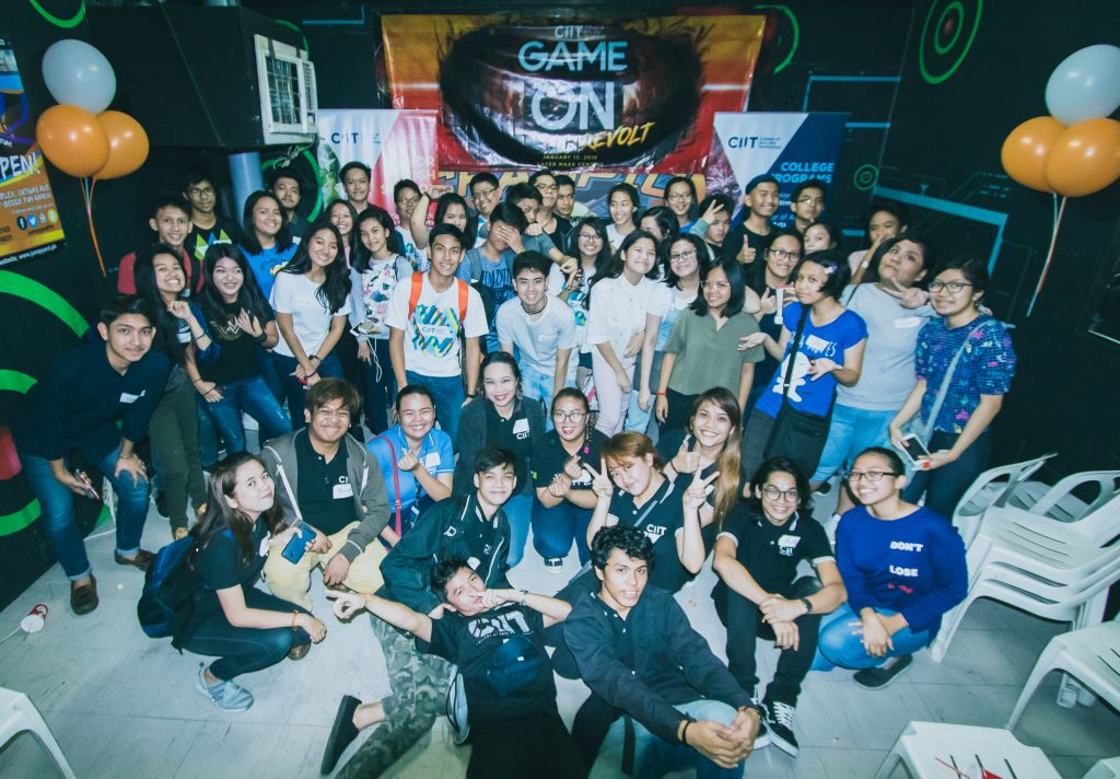 Faculty and Student from CIIT Philippines Speak in Front of Incoming Senior High School Students During GameOn Event