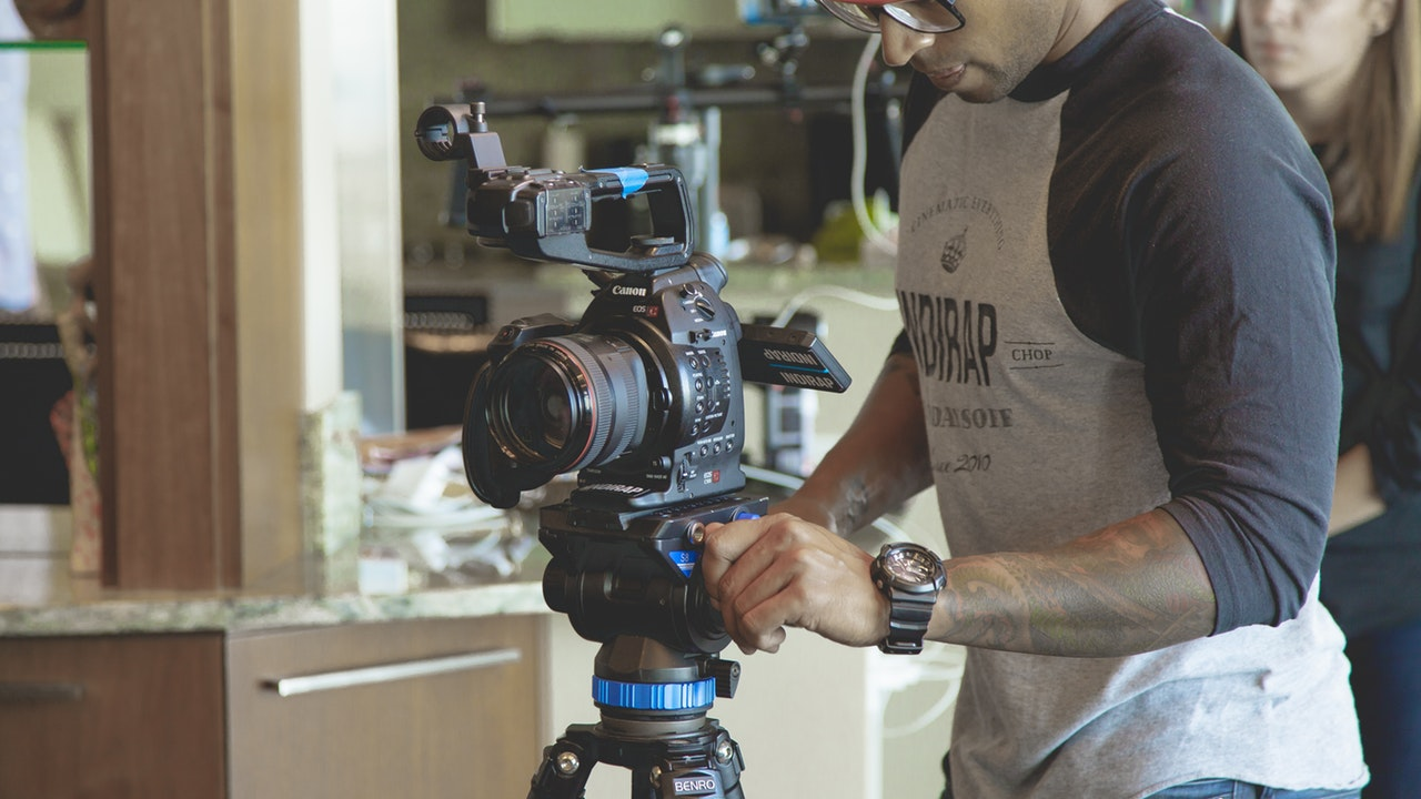 A videographer operating a camera for film and video production