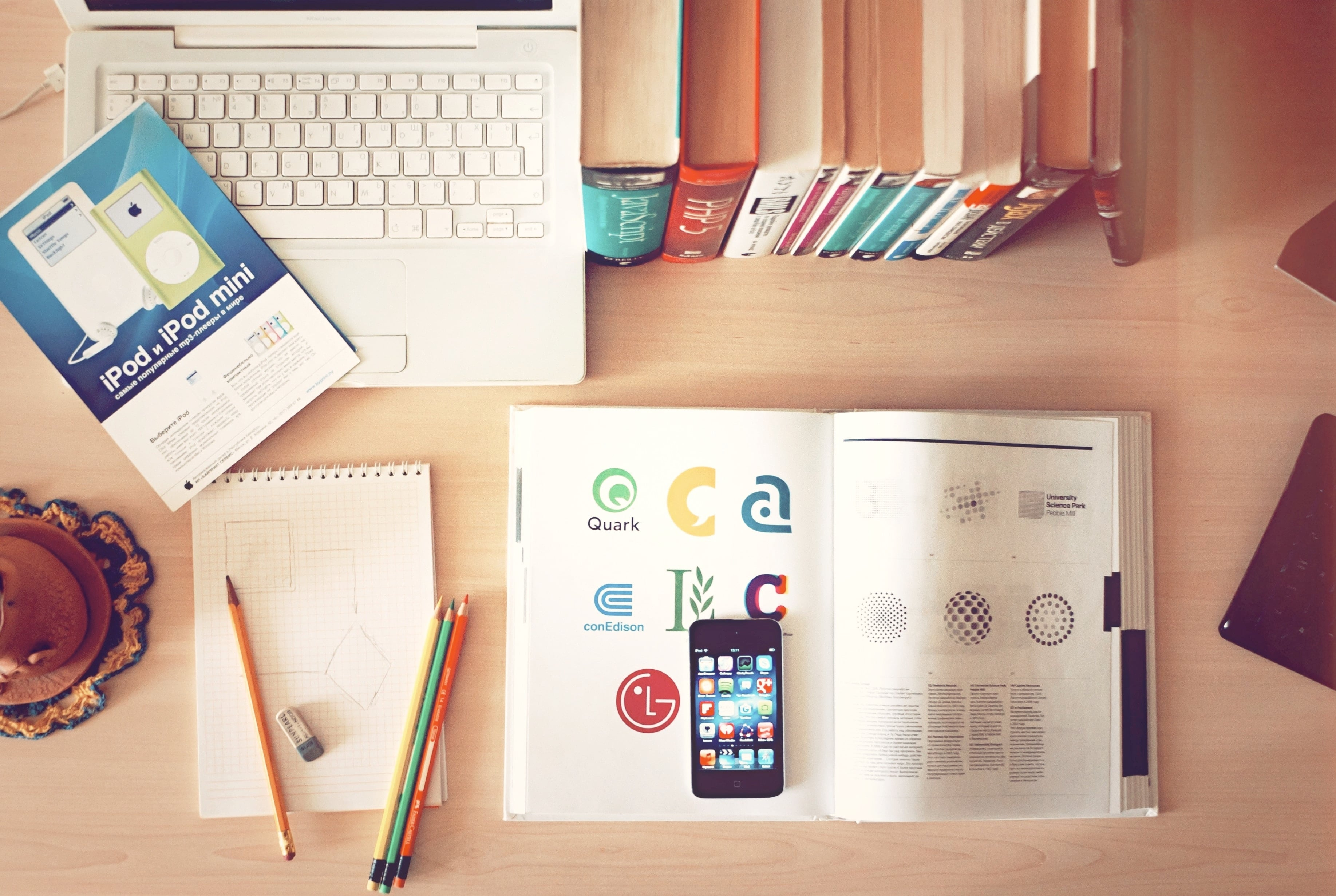 A graphic designer's essentials on a desk for a multimedia course task