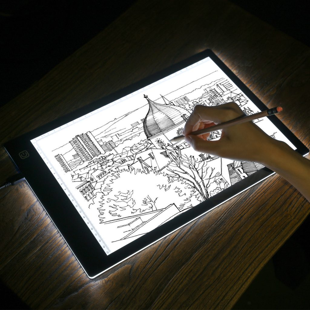 tracing an artwork on a tracing LED light box