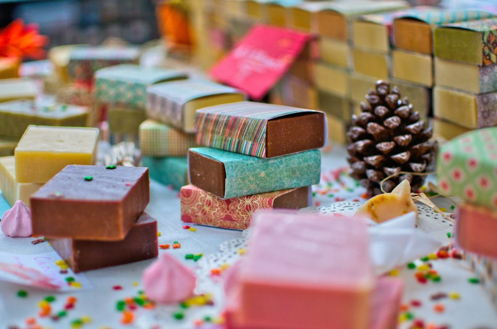Colorful gift soaps on a table for the best gifts for artists
