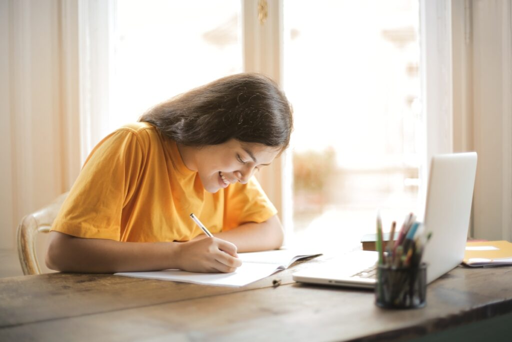 Online education student taking down notes