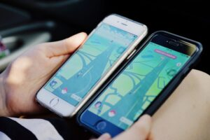two mobile phones showing Pokemon Go, a game developed using Unity Game Engine